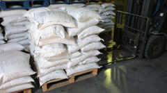 Forklift of transport company load and unload pallets with rice Stock Footage