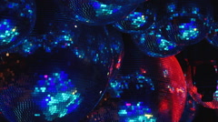 Mirror balls reflect rays of colored lights. - stock footage