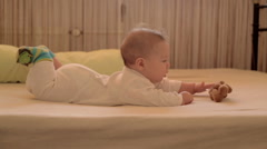 Baby play toy in bed Stock Footage