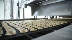Bagels moves on production line Stock Footage