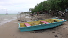 Jamaica sandy beach coastal village fishing boat trap HD 041 Stock Footage