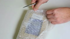 Close up of man hands unpacking small parcel. Shopping with internet. Stock Footage