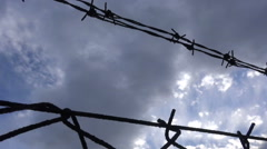 Barbed Wire against the Cloudy Sky  - stock footage