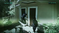 Real surveillance cameras captured and recorded the two robbers enter the house. Stock Footage