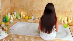 Young woman going to take bath  in her bathroom Stock Footage