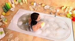 Woman taking  bath and wash sholder on foam in her bathroom Stock Footage