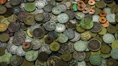 Old and ancient coins covered with copper and rust close up rotation. Stock Footage