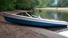 Boat on the sandy shore of the river Stock Footage