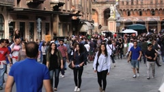 People walk by the street of the city in Bologna, Italy. Stock Footage