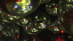 Mirror balls reflect rays of colored lights. Stock Footage