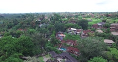 4K AERIAL L2R HIGH ANGLE PAN MOTION AT CAMPUHAN RIDGE IN UBUD BALI - stock footage