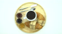 Breakfast, Breakfast set, tray of coffee, croissant, jams, space for text - stock footage