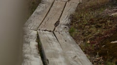 Walking over wooden planks during hike Stock Footage