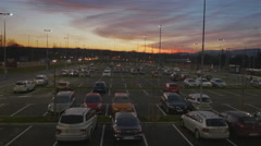 4K Aerial: Dolly Shot Above Parking Area at Dusk - stock footage