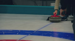 The player rolls a curling stone Stock Footage