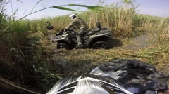 ATV Ride  through the Swamp, Water, Dirt and the Reeds - GoPro cam Stock Footage
