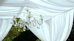 Wedding decorations. crystal chandelier on a arch Stock Footage