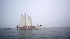 Stock Video Footage of Sailboat with people, foggy Atlantic ocean, Lagos, Algarve, Portugal flag