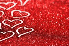 Glitter background with hearts - stock photo