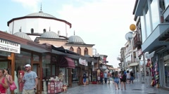 People walking at the main boulevard in the unesco listed town Ohrid Stock Footage