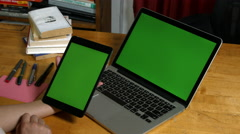 Millennial Girl using a Green Screen ipad and macbook pro - stock footage