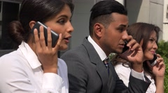 Business People Talking On Cell Phones Stock Footage