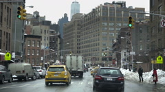 Driving traffic drivers pov Varick Street with winter snow and Freedom Tower NYC Stock Footage