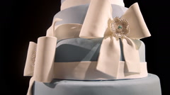 Gourmet tiered wedding cake at wedding reception Stock Footage