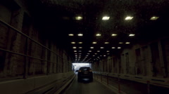 Cars emerging from Brooklyn Battery Tunnel from driver pov driving in NYC Stock Footage
