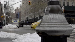 Fire hydrant close up in snow USPS mail truck parked taxi cab driving winter NYC Stock Footage