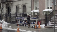 Film production cones on street with equipment and snow in winter NYC Stock Footage