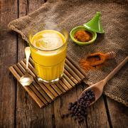 Golden Milk made with turmeric. - stock photo