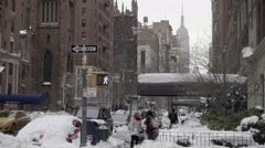 Empire State Building view from Lower Fifth Avenue on snowy day in winter NYC - stock footage
