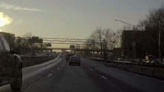 Pickup truck driving on highway at sunset in winter in NYC Stock Footage