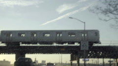 Subway train riding elevated track in Brooklyn from 278 highway in NYC Stock Footage