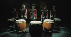 A group of Japanese Taiko drummers girls , start playing  dark background, slow Arkistovideo
