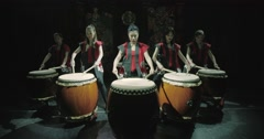 A group of Japanese Taiko drummers girls , start playing with the jump dark Stock Footage