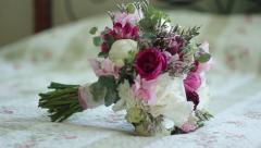 Wedding bouquet on bed - stock footage