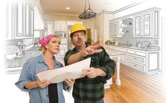 Contractor Talking with Customer Over Kitchen Drawing and Photo Combination Stock Photos