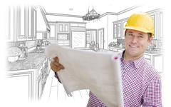 Smiling Contractor Holding Blueprints Over Custom Kitchen Drawing. Stock Photos