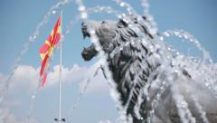 Water show and Lion statues under Alexander the Great Monument in Macedonia Stock Footage