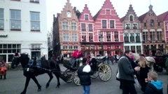 BRUGGE, BELGIUM - JANUARY 2016: Riding phaeton on street at Bruges city center Stock Footage