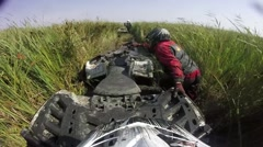 ATV stuck - ATV riders try to pull it out of the Swamp, Water, Dirt and the Reed - stock footage