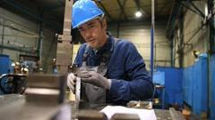 Metal worker using machine in workshop - stock footage