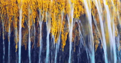 Close up view of calm tropical waterfall with many streams flowing down slowly Stock Footage