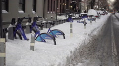Citi Bikes parked at station covered in snow in winter NYC Stock Footage