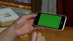Millenial Girl using a Green Screen Smart Phone Stock Footage