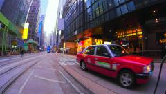 Red taxi cab moving toward camera in city downtown slow motion video Stock Footage