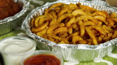 Curly French Fries in a pan in a Brooklyn Apartment Kitchen Stock Footage