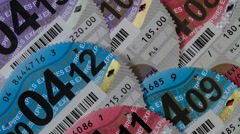 Close up of British car tax disc Stock Footage
